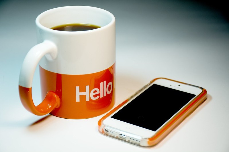 Coffee mug and smartphone on a table